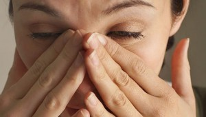 photolibrary_rf_photo_of_woman_with_sinus_pain-493x280